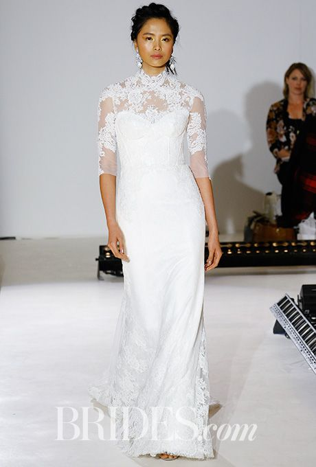 Brides.com: . Style 9651, silk white lace and English net trumpeted gown with shimmer throughout, hand-place Alencon lace accents the corset bodice and hem, high neck Alencon lace jacket, Alvina Valenta 5h